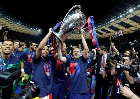 Barcelona's Andres Iniesta, centre, holds the trophy after the Champions League final