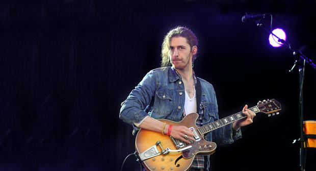 Hozier performs on stage