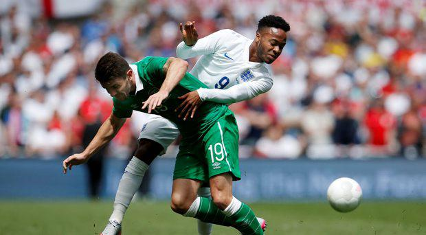 Ireland's Robbie Brady in action with England's Raheem Sterling