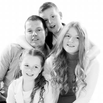 Danny O'Connor and his children, Scott (10), Stacey (8), and Sophie (15) Credit: Save Save The O'Connor Family Home