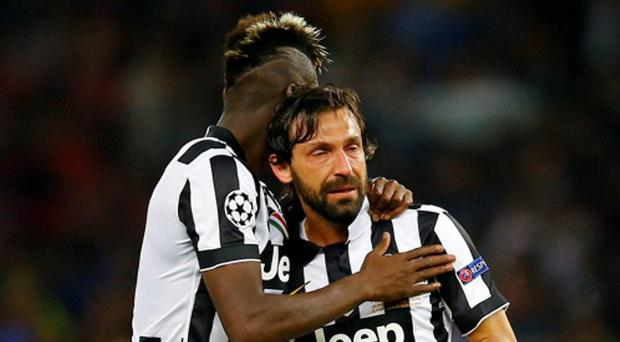 Juventus' Paul Pogba and Andrea Pirlo look dejected at the end of the Champions League Final