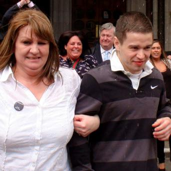 File photo of Sam Hallam leaving the Court of Appeal in London, with his mother Wendy, after he was freed on bail, as he and Victor Nealon, who served long sentences before their convictions were overturned have lost High Court actions in their fight for compensation