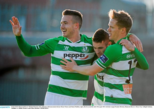 Shamrock Rovers' Michael Drennan, left, celebrates with team-mates Kieran Marty Waters and Simon Madden, right, after he scored his side's first goal