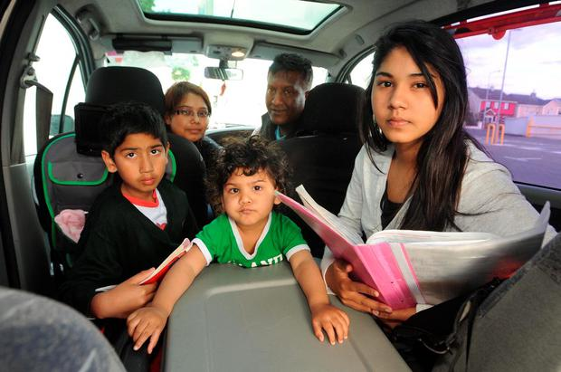 08-06-2015: Killarney Community College Junior Cert student Banisha Kisto (15) who had to study and live in a car with her family while doing her exams . Included are Makash Kisto (9), Poorvi Bipta (20 months), Prema Kisto and Sailesh Bipta. Picture: Eamonn Keogh (macmonagle.com) STORY : ANNE LUCEY