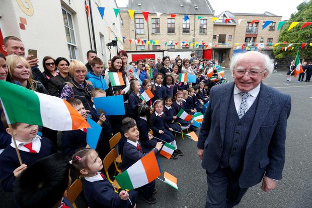 Pictured at the official opening of 3 refurbished rooms in Gardiner Street School that once operated as a food centre for the local community was pupils from Gardiner Street School welcoming President of Ireland, Michael D Higgins