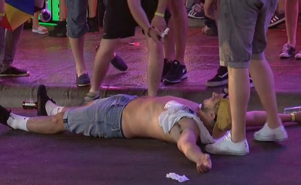 Screen grab taken from PA Video of tourists on the Punta Ballena strip in Magaluf, Spain, as the town saw tough new rules cracking down on drunkenness come into force at midnight - but the resort still witnessed the debauched scenes that have made it infamous. PA Video/PA Wire