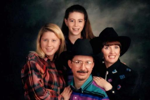 Julia Holmes with her second husband Clyde Parrish from Texas and her stepdaughters Kimberly (left) and Rosalyn (top)