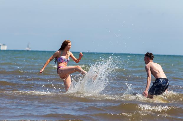 Zoe Fitzmaurice and Seamus McCarthy from Dublin having fun at Dollymount beach during the good weather
