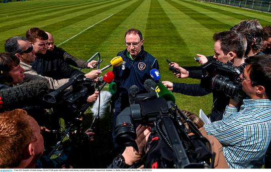 Ireland manager Martin O'Neill speaks with assembled media during a team pitchside update