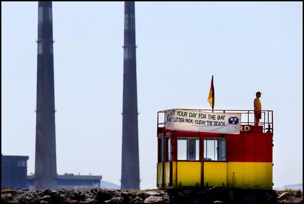 A lifeguard in duty on Dollymount Strand during the warm weather. Pic Steve Humphreys
