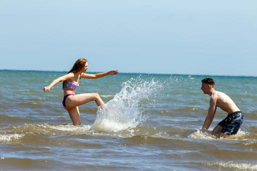 Zoe Fitzmaurice and Seamus McCarthy from Dublin having fun at Dollymount beach during the good weather. Pic:Mark Condren=