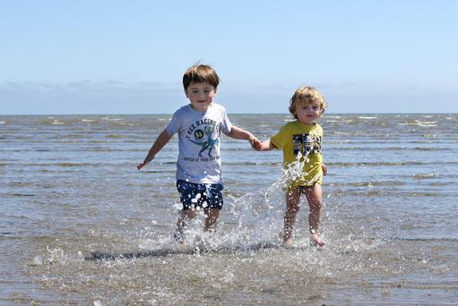Four and a half year old Archie Williams from Melbourne, Australia cools down in the Irish Sea with his brother Sonny [3] during their trip to Dollymount strand. Pic Frank Mc Grath
