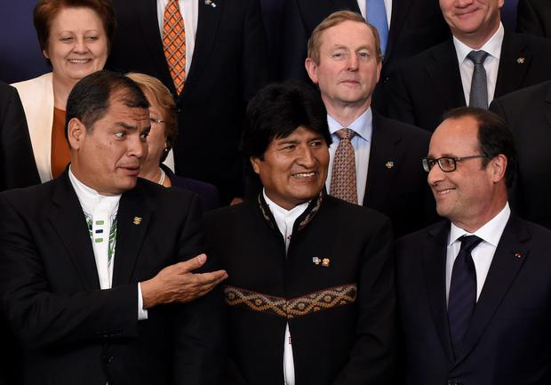 Ecuadorian President Rafael Correa (left), Bolivian President Evo Morales Ayma, Taoiseach Enda Kenny and French President Francois Hollande at a photo call during a European Union and the Community of Latin America and Caribbean states summit in Brussels