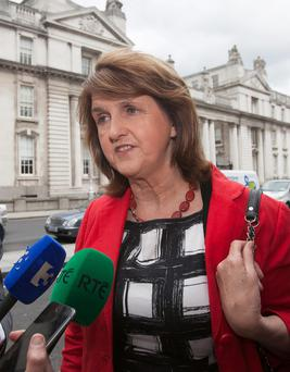 Tánaiste Joan Burton said distributing the grant in the early part of the year would make it easier for households in terms of financial planning