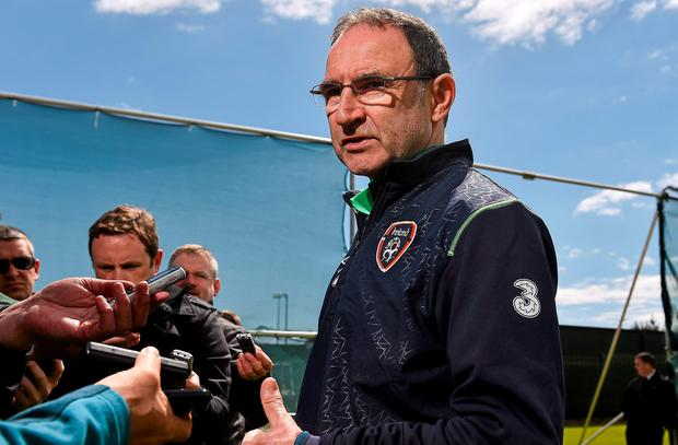 Republic of Ireland manager Martin O'Neill speaks with assembled media during a team pitchside update