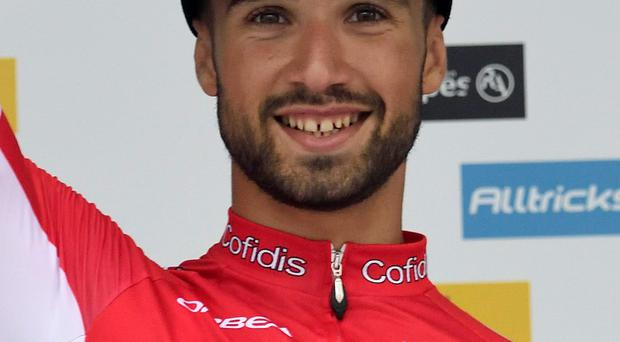 Nacer Bouhanni celebrates on the podium after winning the fourth stage of the Dauphine Criterium between Anneyron and Sisteron