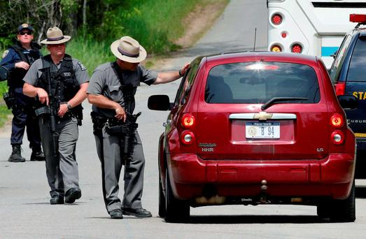 Law enforcement officials man a roadblock while searching a wooded area near Dannemora, New York. Photo: PA