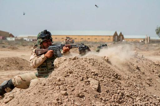 Iraqi soldiers train with members of the US Army's 82nd Airborne Division, at Camp Taji, Iraq. Photo: Reuters