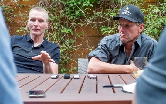 Lance Armstrong (right) and Geoff Thomas talk with journalists in Aspen, Colorado Sunday May 31, 2015 while Geoff Thomas looks on. Armstrong will ride with Geoff Thomas and the Tour de France One Day Ahead riders in July in France during the Tour de France.