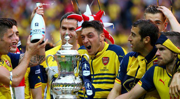 Arsenal's Mesut Ozil celebrates with the trophy after winning the FA Cup Final