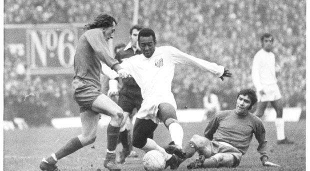 Johnny Fullam tackles Pele on ground