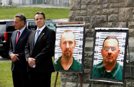 Vermont Governor Peter Shumlin (left) and New York Governor Andrew Cuomo at a news conference in New York state with photos of the two escapees, David Sweat (left) and Richard Matt. Photo: Reuters