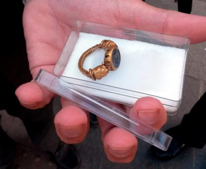 An ornate Roman gold ring found by retired civil servant Brian Murray on Murlough beach in Co Down is shown outside a coroner's court in Belfast after it was officially declared as treasure. David Young/PA Wire