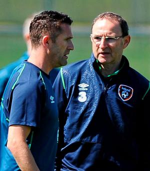 Robbie Keane and Martin O'Neill deep in discussion in Malahide yesterday
