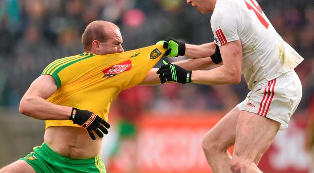 Donegal's Neil Gallagher and Sean Cavanagh of Tyrone tussle off the ball during the Ulster SFC clash last month