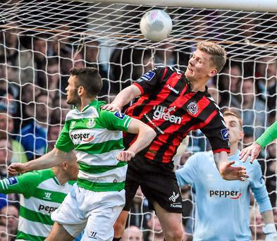 Derek Prendergast jumps highest to score the equaliser for Bohemians last night