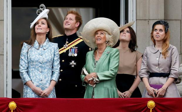 Britain's (L-R) Catherine, the Duchess of Cambridge, Prince Harry, Camilla the Duchess of Cornwall and Princesses Eugenie and Beatrice stand on the balcony at Buckingham Palace after attending the Trooping the Colour ceremony