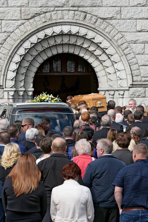 Pall bearers carry the coffin of toxic fumes victim, Alan Harris, into St. Agnes Church, Crumlin, Dublin 12, for the funeral service. (Photo: Conor O'Mearain)