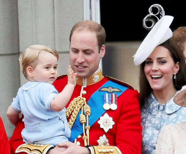 Britain's Prince Willian holds Prince George as he waves with Catherine, the Duchess of Cambridge on the balcony at Buckingham Palace after attending the Trooping the Colour ceremony at Horse Guards Parade in central London, Britain June 13, 2015. Trooping the Colour is a ceremony to honour the Queen's official birthday. REUTERS/Stefan Wermuth TPX IMAGES OF THE DAY