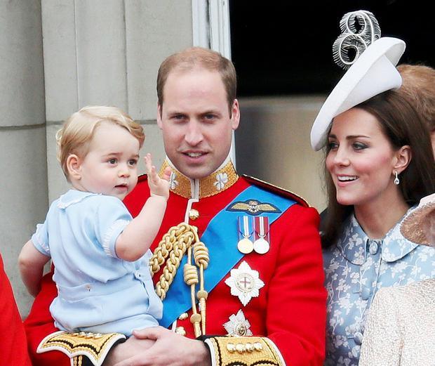 Britain's Prince William holds Prince George as he waves with Catherine, the Duchess of Cambridge on the balcony at Buckingham Palace after attending the Trooping the Colour ceremony at Horse Guards Parade in central London, Britain June 13, 2015. Trooping the Colour is a ceremony to honour the Queen's official birthday. REUTERS/Stefan Wermuth