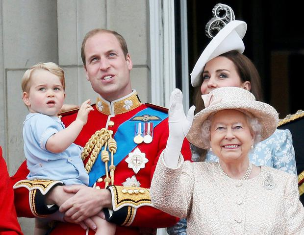 Britain's Prince Willian holding Prince George, Catherine, the Duchess of Cambridge and Queen Elizabeth stand on the balcony at Buckingham Palace after attending the Trooping the Colour ceremony at Horse Guards Parade in central London, Britain June 13, 2015. Trooping the Colour is a ceremony to honour the Queen's official birthday. REUTERS/Stefan Wermuth