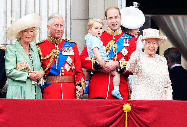 (Left-right) the Duchess of Cornwall, the Prince of Wales, Prince George, the Duke and Duchess of Cambridge and Queen Elizabeth II on the balcony at Buckingham Palace following Trooping the Colour at Horse Guards Parade, London. PRESS ASSOCIATION Photo. Picture date: Saturday June 13, 2015. See PA story ROYAL Trooping. Photo credit should read: Jonathan Brady/PA Wire