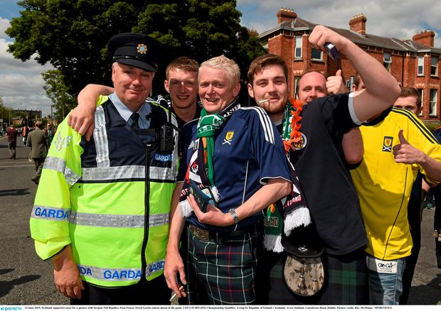 13 June 2015; Scotland supporters pose for a picture with Sergent Neil Randles, from Pearce Street Garda station ahead of the game. UEFA EURO 2016 Championship Qualifier, Group D, Republic of Ireland v Scotland, Aviva Stadium, Lansdowne Road, Dublin. Picture credit: Ray McManus / SPORTSFILE