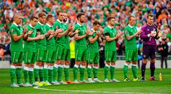 13 June 2015; The Republic of Ireland team observe a minute's applause before the start of the game. UEFA EURO 2016 Championship Qualifier, Group D, Republic of Ireland v Scotland, Aviva Stadium, Lansdowne Road, Dublin. Picture credit: Seb Daly / SPORTSFILE