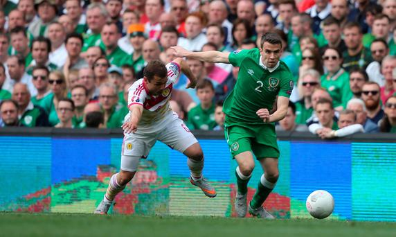 Scotland's Shaun Maloney and Ireland's Seamus Coleman (right) battle for the ball during the UEFA European Championship Qualifying match at the Aviva Stadium