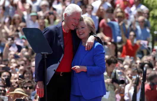 U.S. Democratic presidential candidate Hillary Clinton is embraced by her husband former President Bill Clinton (L) after she delivered her