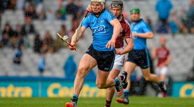 Restoring Liam Rushe, pursued above by Galway's Aidan Harte, to centre half-back could be central to Dublin's hopes of recovering from last weekend's defeat. Photo: Dáire Brennana / SPORTSFILE