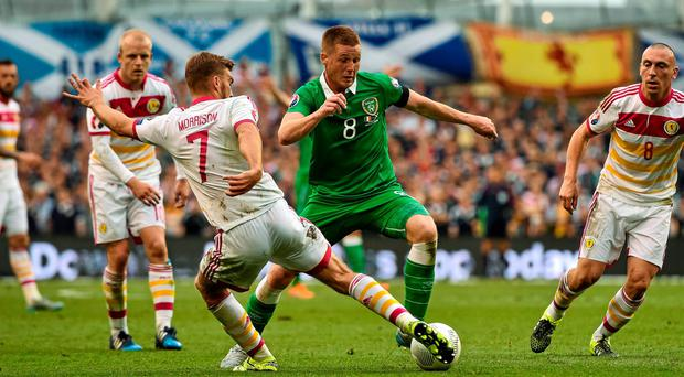Ireland midfielder James McCarthy looks to drift past Scotland's James Morrison. Photo: David Maher / SPORTSFILE