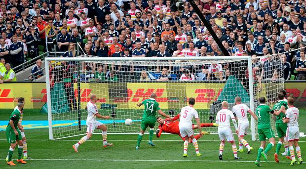 Jonathan Walters puts Ireland ahead against Scotland. Photo: Cody Glenn / SPORTSFILE