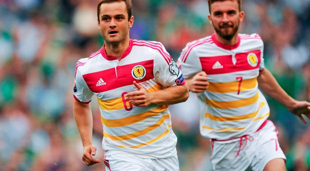 Shaun Maloney celebrates after scoring Scotland's equalising goal against Ireland in June