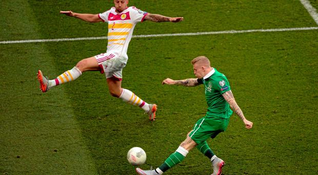 Ireland's James McClean tries to get a cross past Scotland defender Alan Hutton. Photo: Cody Glenn / SPORTSFILE