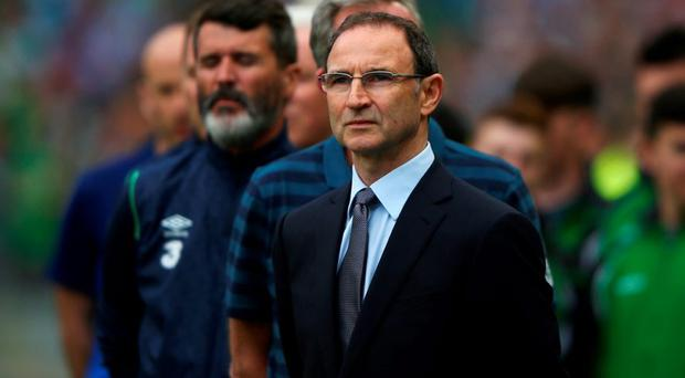 Martin O'Neill, manager of Republic of Ireland looks on with assistant Roy Keane