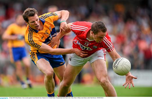 14 June 2015; Brian Hurley, Cork, in action against Ciaran Russell, Clare. Munster GAA Football Senior Championship Semi-Final, Cork v Clare. Páirc Ui Rinn, Cork. Picture credit: Matt Browne / SPORTSFILE