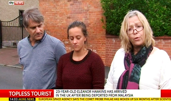 Video grab taken from Sky News of Eleanor Hawkins (centre) with her parents Timothy and Ruth as they made a statement outside their family home in Draycott, Derbyshire, apologising for any offence Eleanor caused by stripping on a Malaysian mountain which is considered sacred. Sky News/PA Wire