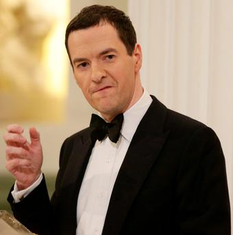 George Osborne's plan to enshrine permanent budget surpluses in law was attacked in a letter signed by 77 academics