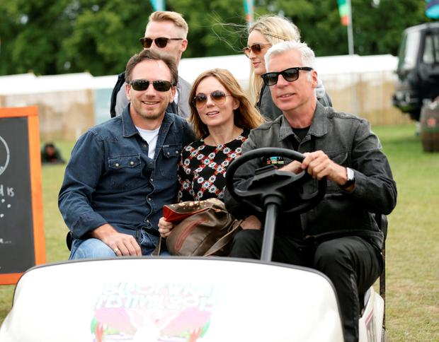 Festival Organiser John Giddings (right) driving Geri Halliwell and her husband Christian Horner (front left), and Ronan Keating (back left) and girlfriend Storm Uechtritz (back right) backstage at the Isle of Wight Festival, in Seaclose Park, Newport, Isle of Wight. PRESS ASSOCIATION Photo. Picture date: Sunday June 14, 2015. Photo credit should read: Yui Mok/PA Wire